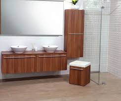 wall mounted vanity with matching tall cabinet in natural walnut