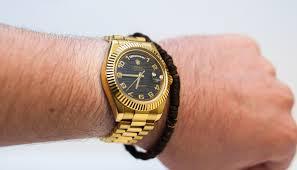 golden rolex rolex day date gold black dial
