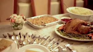 thanksgiving table carving turkey ham mashed potatoes side dishes