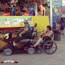 Merica Wheelchair Meme - fat man in motorized scooter tows woman in wheelchair at the fair