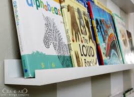 Narrow Picture Ledge Displaying Books In The Playroom Jones Design Company