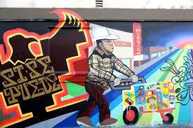 the writing on the wall it s graffiti versus murals in san it s graffiti