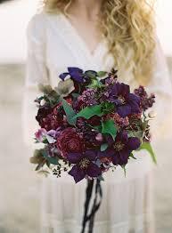 purple bouquets clematis bridal bouquets in season now brides