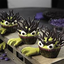 Halloween Baby Shower Cupcakes by Halloween Monster Cupcakes With Candy Hands Wilton