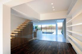 dark wood flooring stairs glass wall modern home in london by