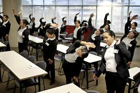 learning to bow japan reluctantly opens door to foreign trainee housekeepers do stretching exercises during a training session at the magsaysay center for hospitality and