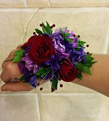 wrist corsages for homecoming purple and designer s choice prom wrist corsage created by