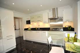 White Gloss Kitchen Cabinets by Granite Countertop Black Gloss Kitchen With White Worktops