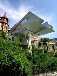 Modern Two Storey House With Streamline Roof by 20 Beautiful And Modern Cantilevered Buildings From All Over The World