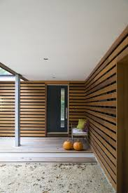 best 25 cedar siding ideas on pinterest wood siding clapboard the slatted cedar siding continues to wrap around the front door leading visitors to a new
