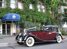roll royce maroon about a stylish arrival vintage wedding car rental vancouver