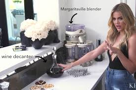 khloe kardashian shows her organized bar with a vodka fridge