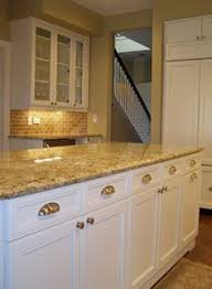 Granite Countertops With White Kitchen Cabinets by St Cecelia Granite Countertop White Kitchen Cabinets With