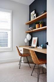 navy paneled wall behind desks open wood shelving long wood