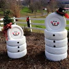 make snowmen out of old tires love this idea for christmas