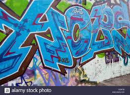 brightly coloured colored aerosol spray paint graffiti wall art