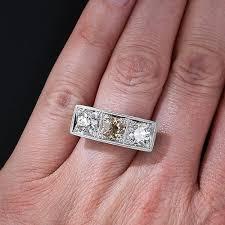 art deco three stone diamond and platinum ring