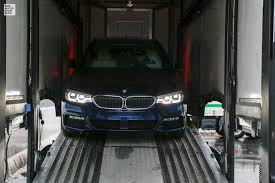 behind the scenes bmw 5 series touring arrives at geneva