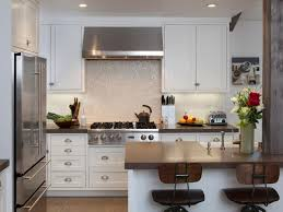 self adhesive backsplashes pictures ideas from hgtv hgtv transitional kitchen with dark wood cabinets and granite backsplash