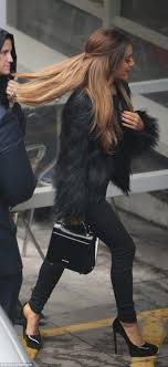ariana grande steps out in fluffy coat as she leaves the itv studios