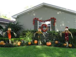 simpler decoration with scarecrow and pumpkin are a lot next to