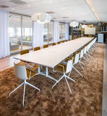 modern large meeting room with soft brown carpet and modern office