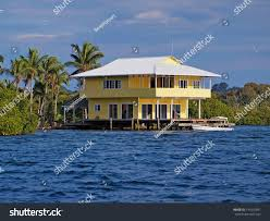 tropical stilt house over water boat stock photo 141010891