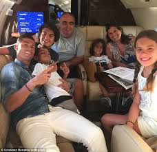 cristiano ronaldo all smiles as he jets to travel with family