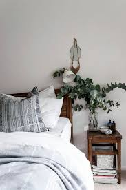 wood in soothing mix of gray white and wood in the bedroom with an