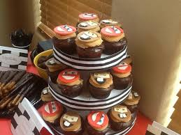 disney cars cupcakes lightning mcqueen and tow mater fondant toppers the cupcakes are a chocolate cupcake with salted caramel filling dipped in ganache