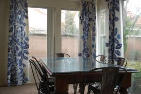 dining room curtain drapes white wall paint and big window plus