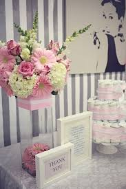 baby shower arrangements for table baby shower flowers glass jar bottom pink themed strip grey wall