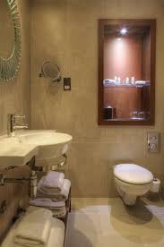 Spa Inspired Bathroom - spa inspired bathrooms feature rainfall showers u0026 aveda toiletries