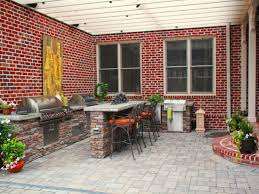 Backyard Pub And Grill by Traditional Brick Walls Enclose This Contemporary Patio Featuring