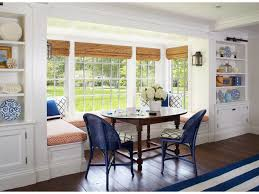 arched transom windows white walls recessed lights natural light