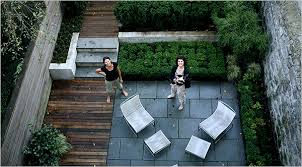 City Backyard Ideas One City Backyard Evolves Into Three Cement Patio Railroad Ties