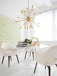 modern dining room decor with wall art and contemporary chandelier