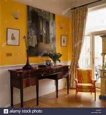 Upholstered Console Table Large Painting Above Antique Console Table In Bright Yellow Hall