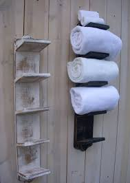 bathroom wall mounted rustic wood towel storage hanging on wooden