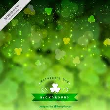 bokeh st s day background with decorative clovers vector