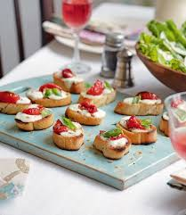 simple vegetarian canapes smoked garlic and melted mozzarella bread delicious magazine