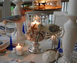 Beach Theme Centerpiece Ideas by Beach Themed Table Setting With Crab Plates Shell Centerpiece And
