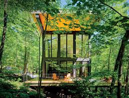 photo 1 of 4 in a little cabin cantilevered over a rocky ledge in