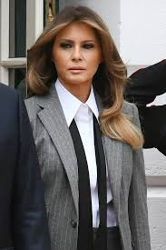 hairstyles to suit fla melania trump wore a pinstripe suit to meet the trudeaus instyle com