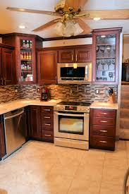 granite countertop kitchen cabinets with bulkhead backsplash