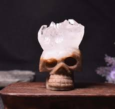 small beautiful hand carved stone skull crystal cluster carved