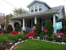 Formal Front Yard Landscaping Ideas - american style house with modern front yard landscape design with