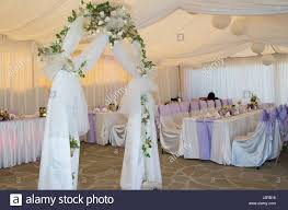 wedding arch decorations wedding arch decorated with veil and white roses stock photo