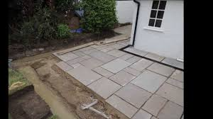 autumn green slabs laid new drains installed drainage and brick