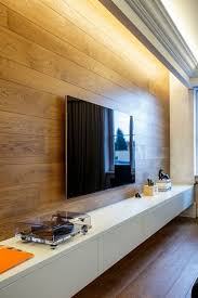 wooden wall panelling adds warmth to the sophisticated living room